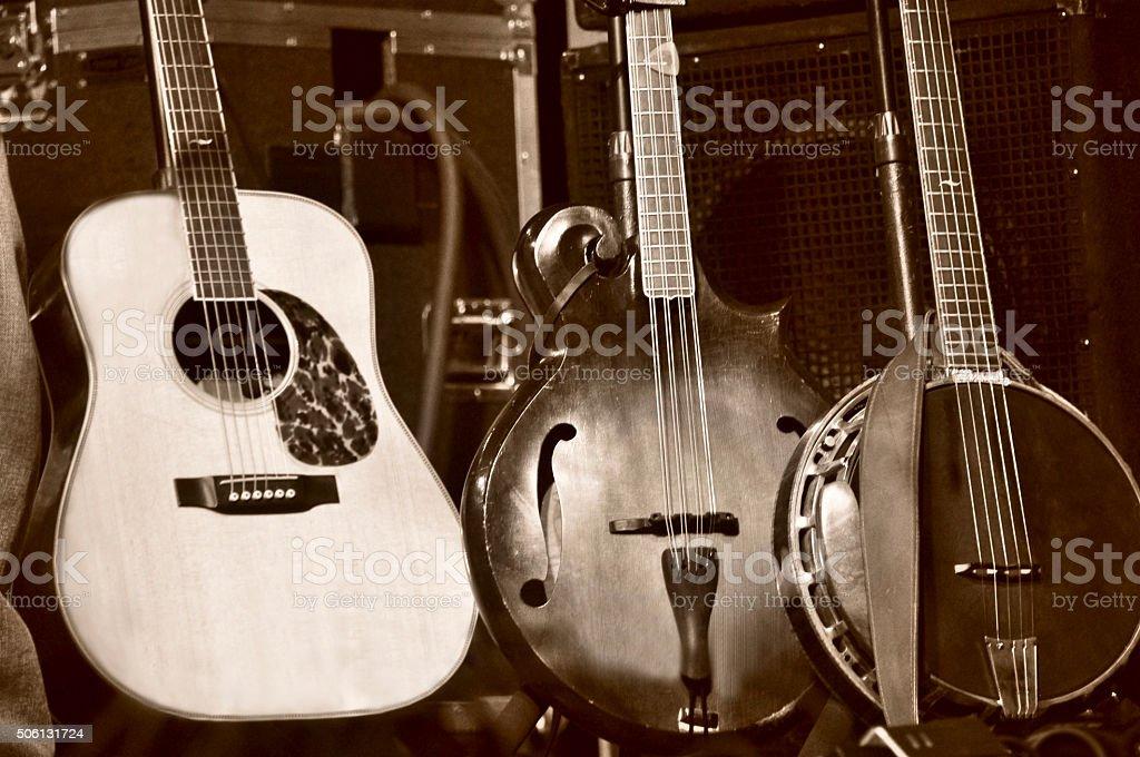 Three Stringed Folk Instruments on Stage stock photo