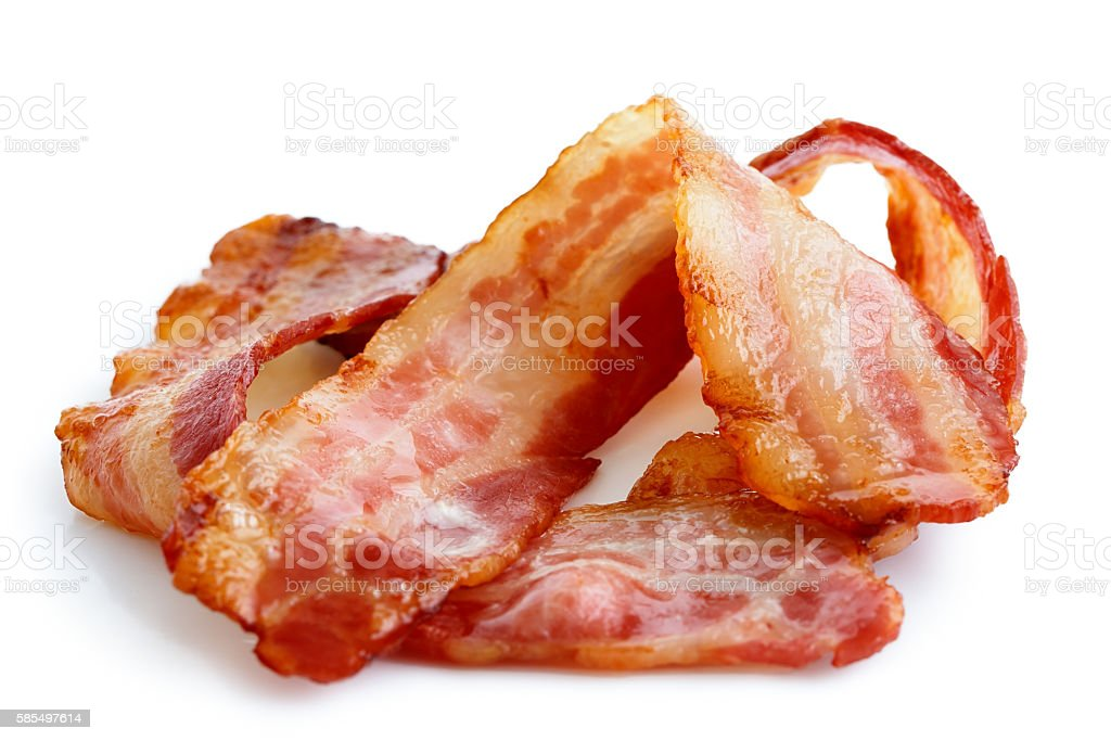 Three strips of fried crispy bacon isolated on white. stock photo