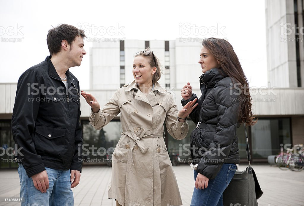 Three students discussing stock photo