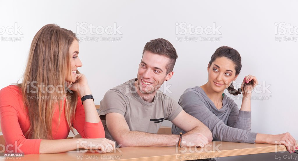 Three students in lecture hall stock photo