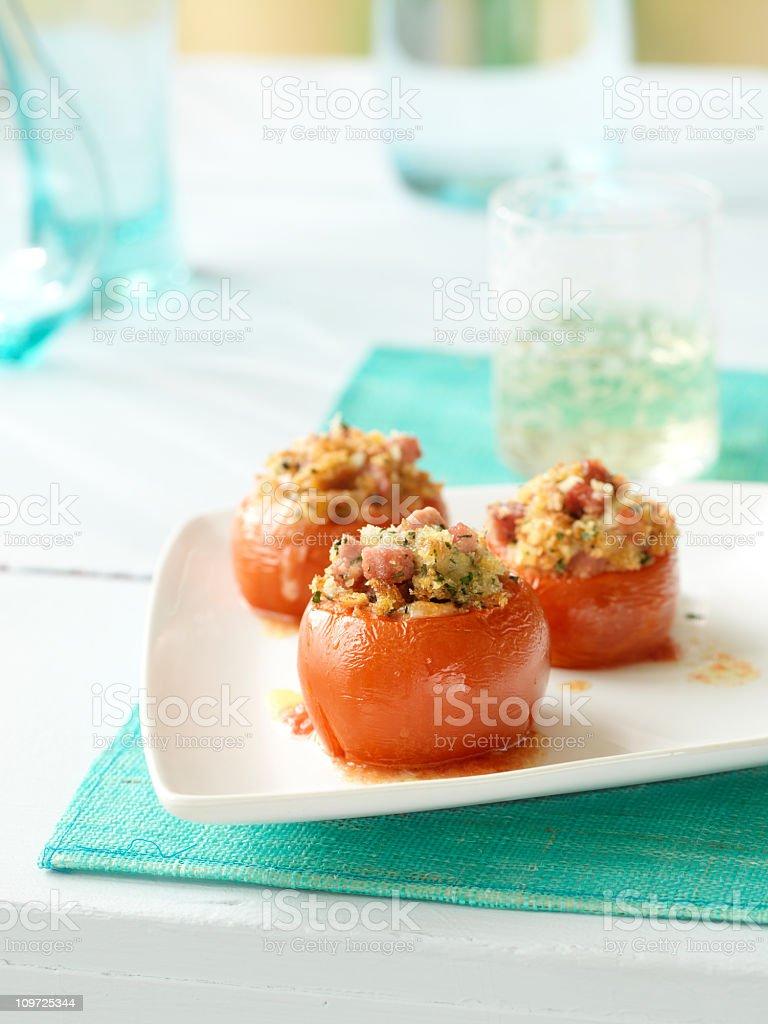 Three stuffed tomatoes on a white dish royalty-free stock photo