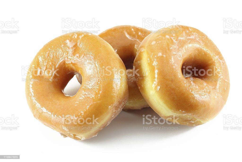 Three sugar glazed yummy donuts stock photo