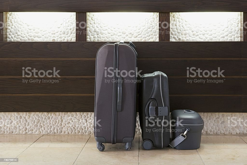 Three suitcases in a row stock photo