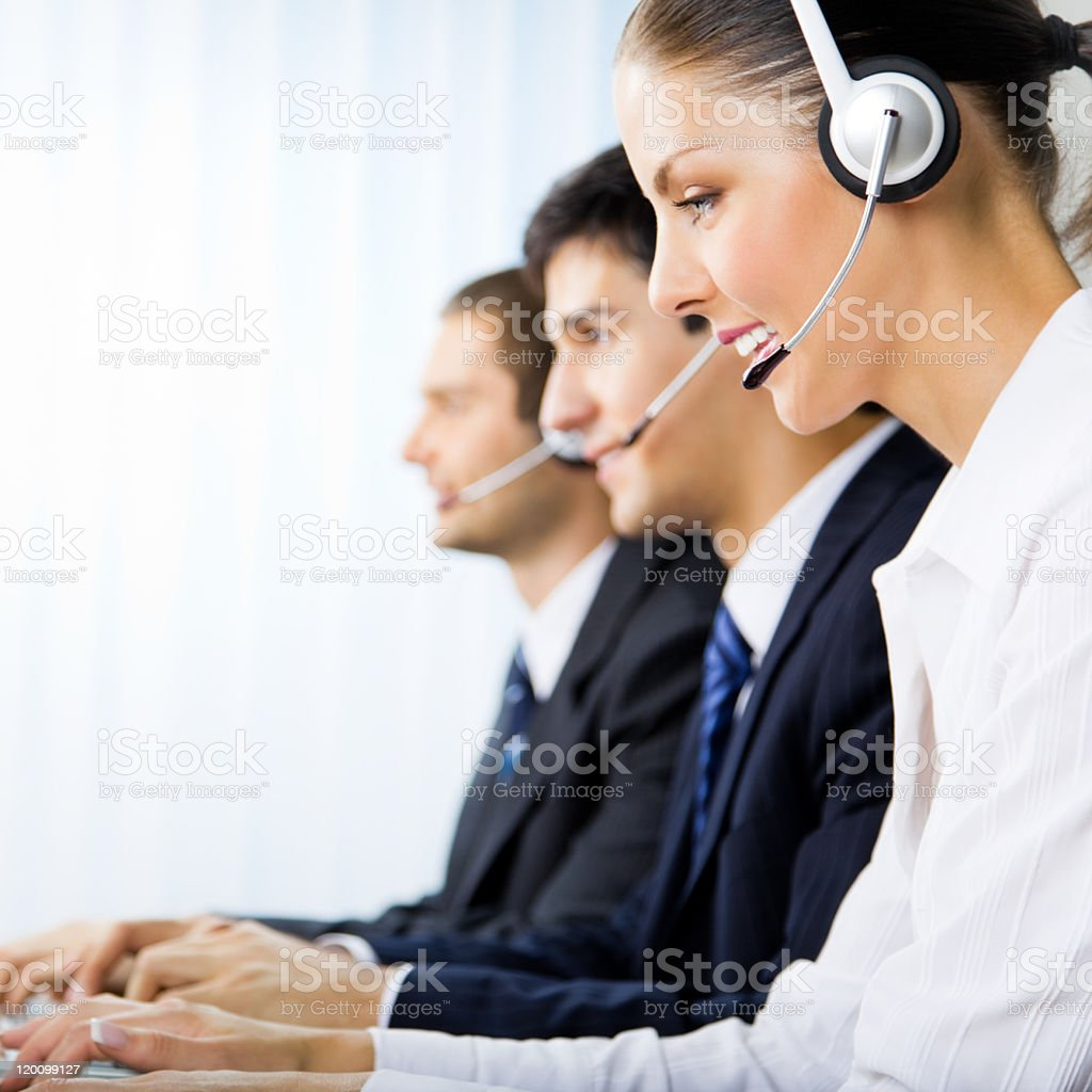 Three support phone operators at workplace royalty-free stock photo