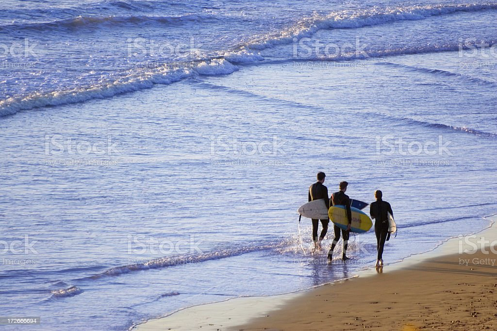 Three Surfers stock photo