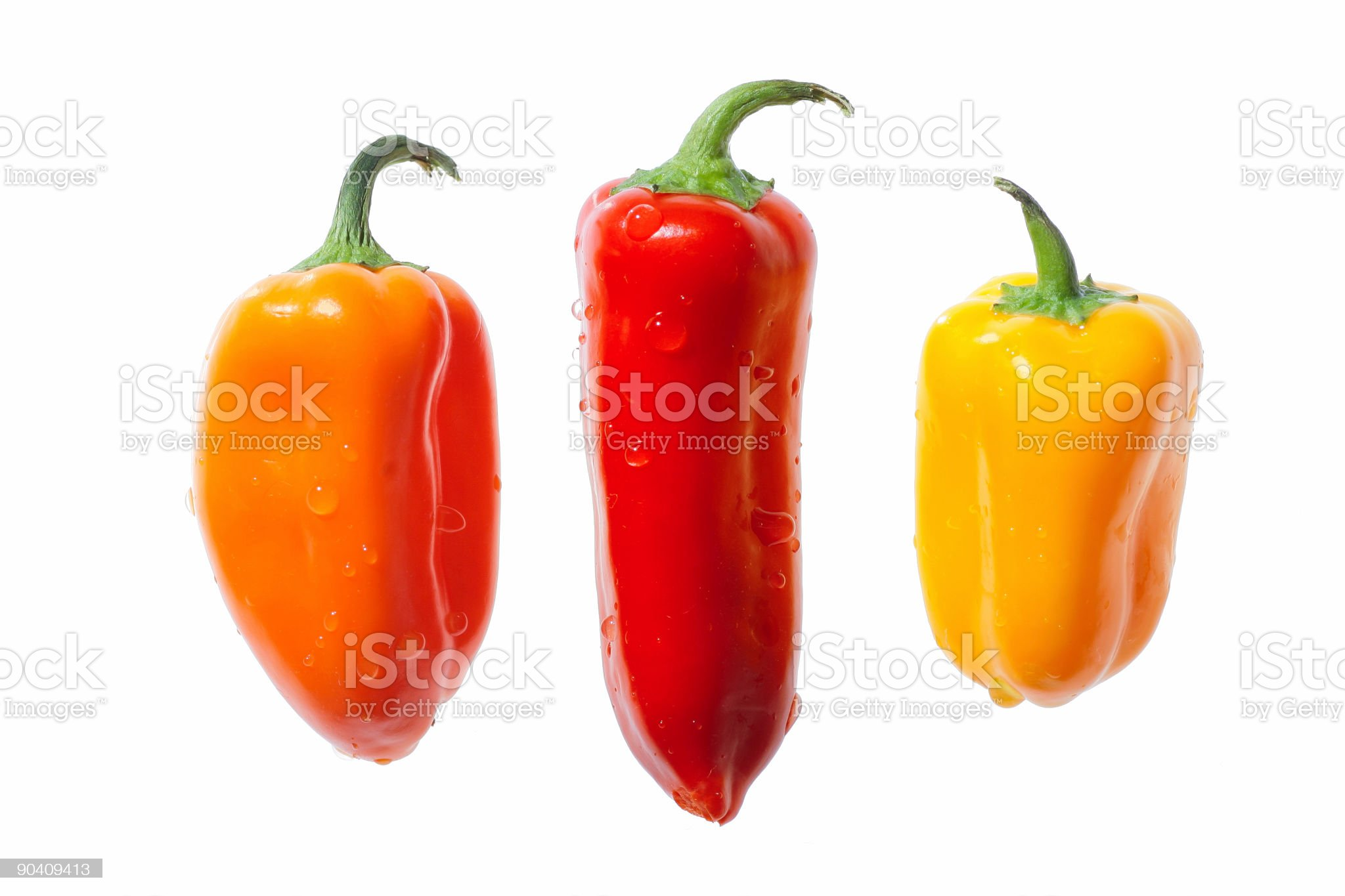 Three Sweet Peppers Isolated On White royalty-free stock photo