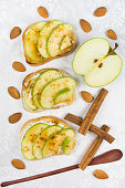Three sweet toasts with cheese, apples and honey