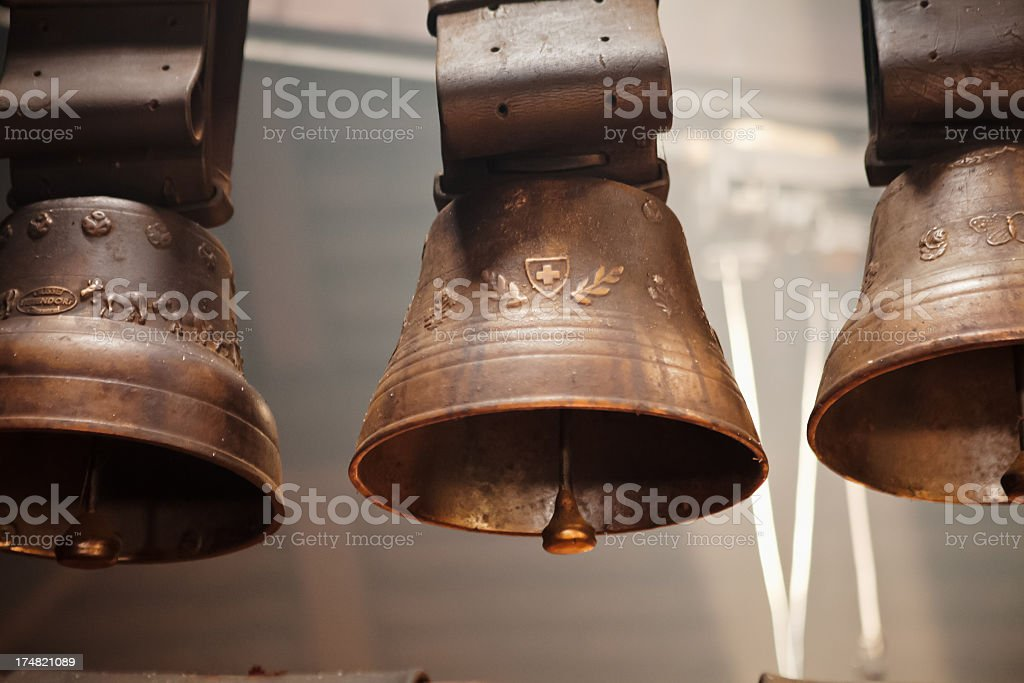 Three Swiss cow bells engraved with Swiss symbols stock photo