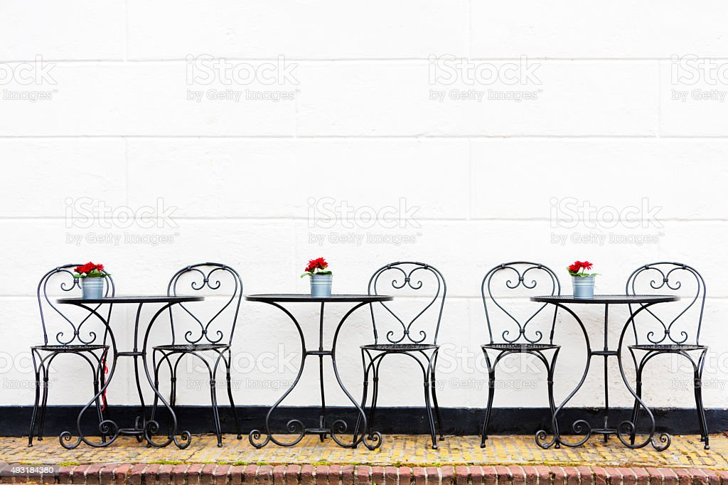 Three Tables with Chairs at Street Restaurant, Brielle, Netherlands stock photo