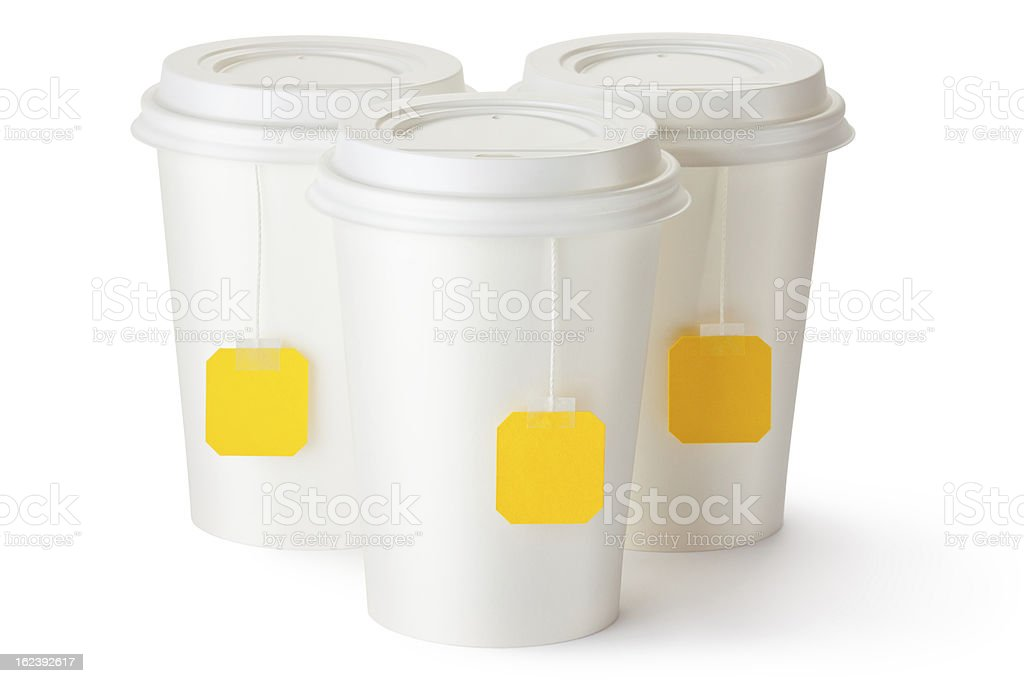 Three take-out teacups with teabags royalty-free stock photo