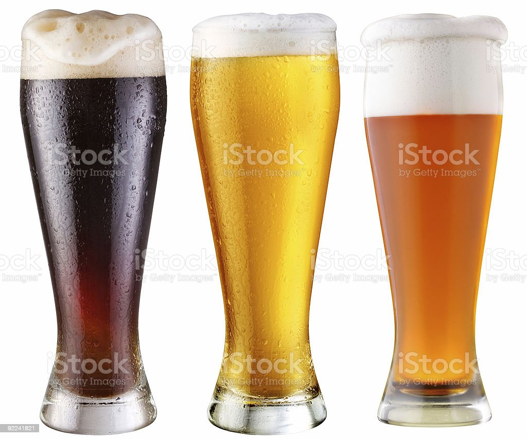 Three tall glasses of different beers isolated on white stock photo