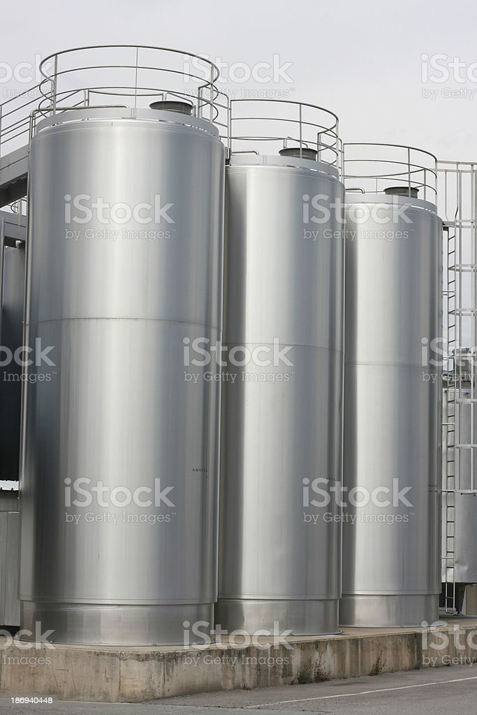 Three tall stainless steel vats used in making cheese royalty-free stock photo