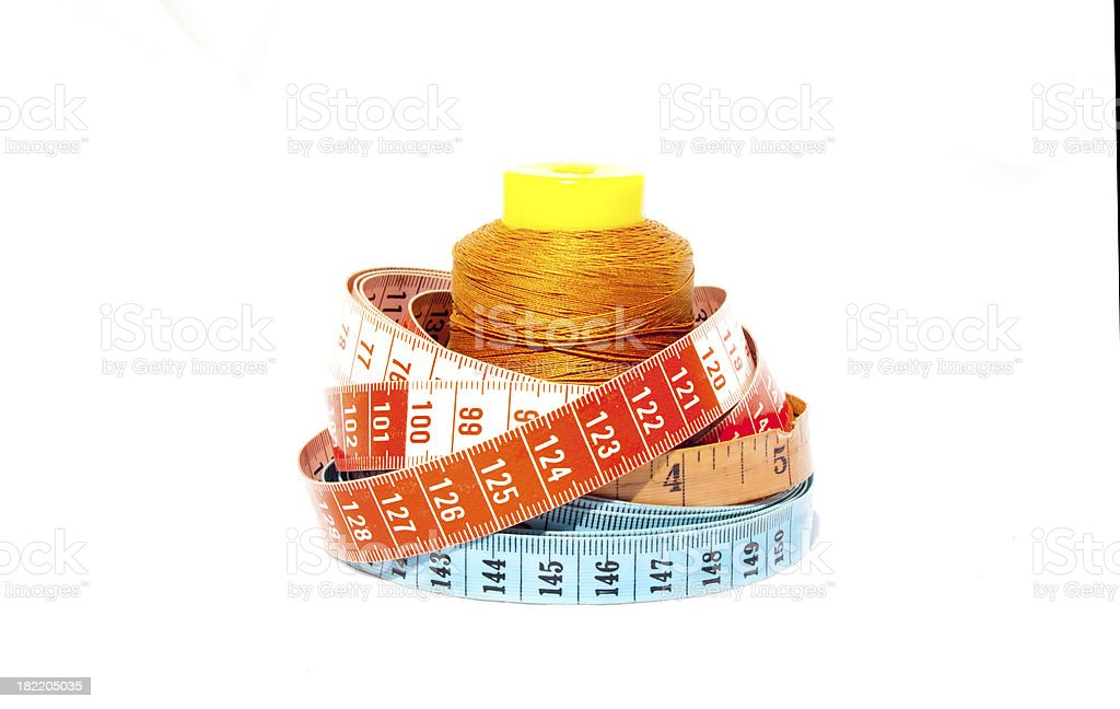 Three Tape Measures With Roll Of Cotton royalty-free stock photo