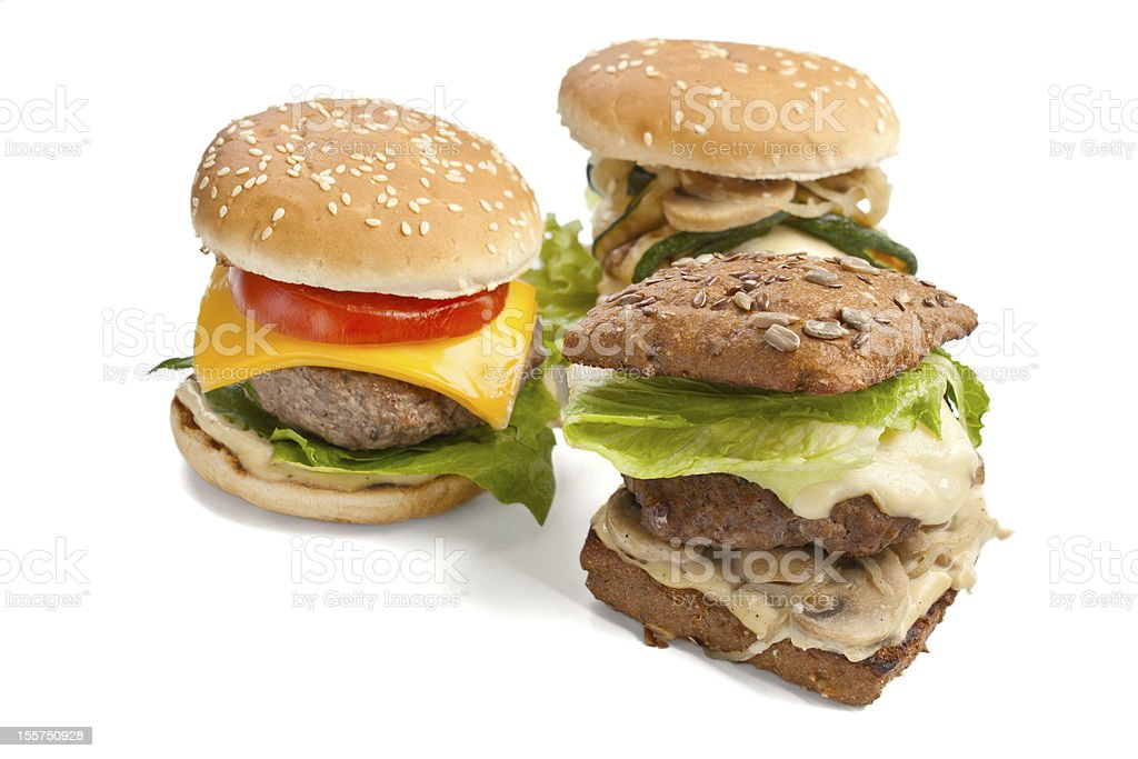 three  tasty fresh cheeseburgers royalty-free stock photo