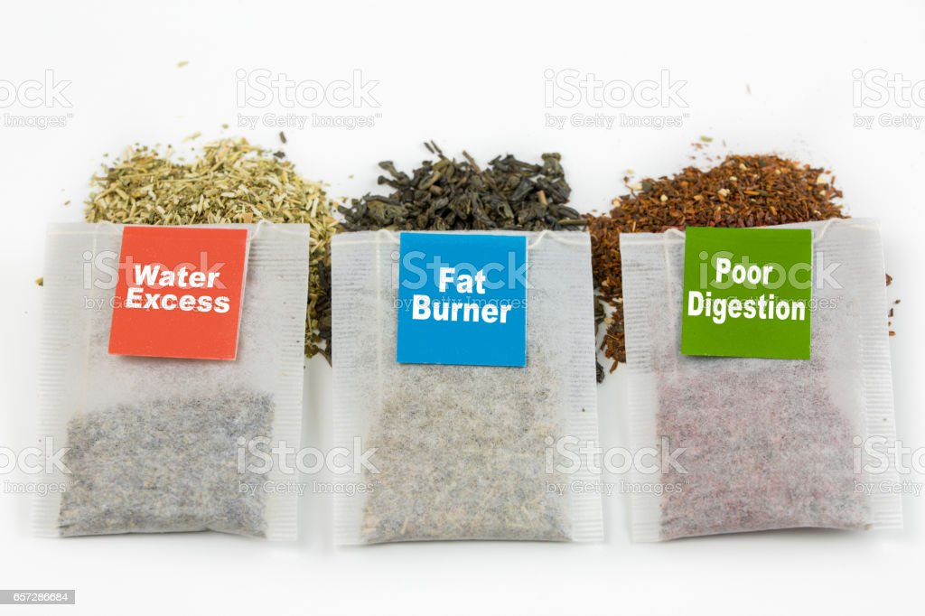 Three tea bags placed on natural tea stock photo