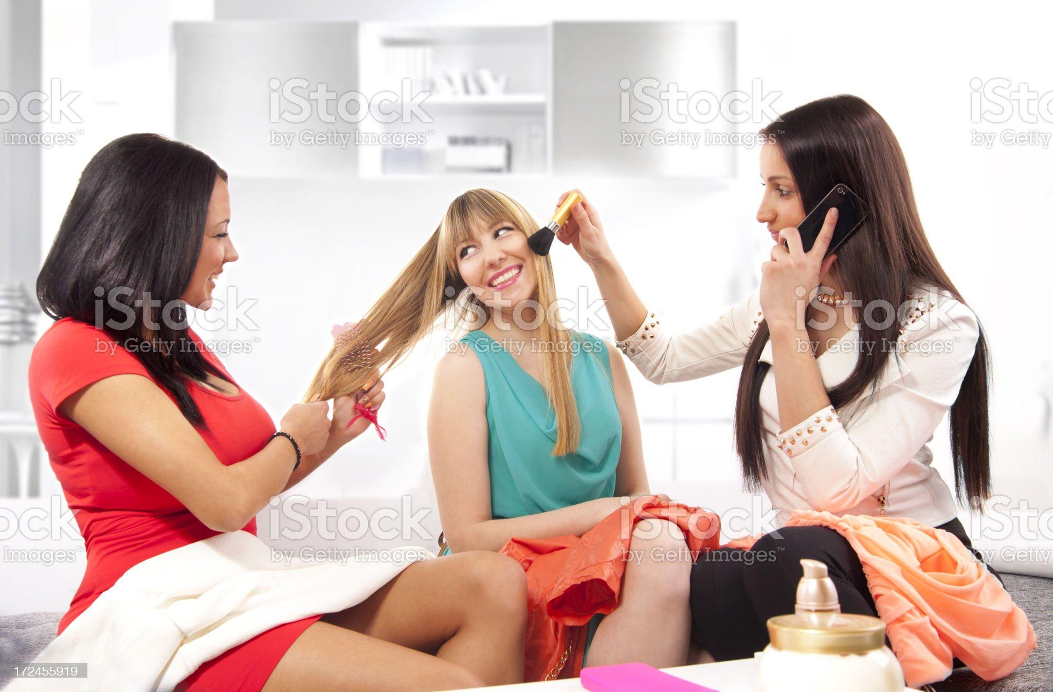 Three teenage girls applying a make-up. royalty-free stock photo