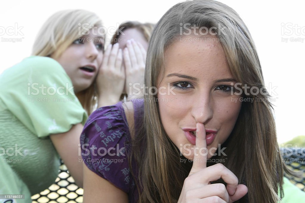 Three Teenage Girls Get Together Telling Secrets royalty-free stock photo