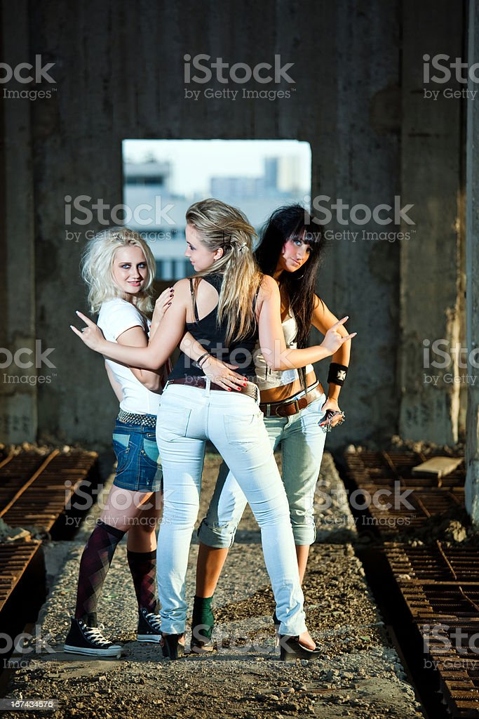 Three teenage girls in abandoned building royalty-free stock photo