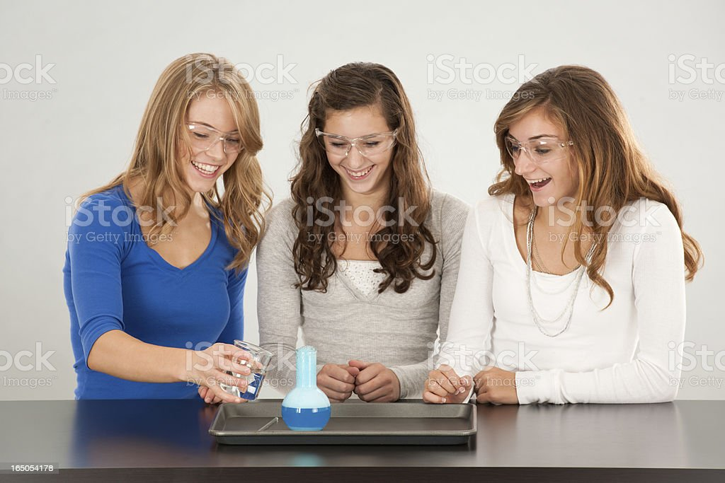 Three Teens Excited by Chemical Reaction! stock photo