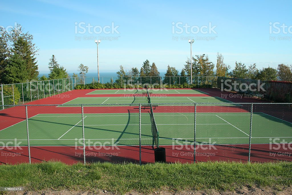 Three tennis courts stock photo