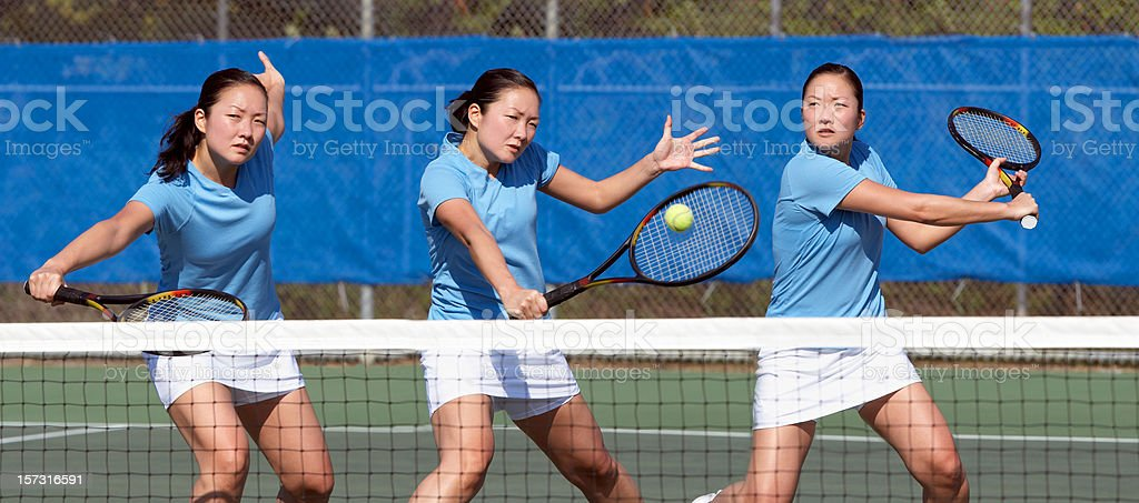 three tennis players in blue practicing royalty-free stock photo
