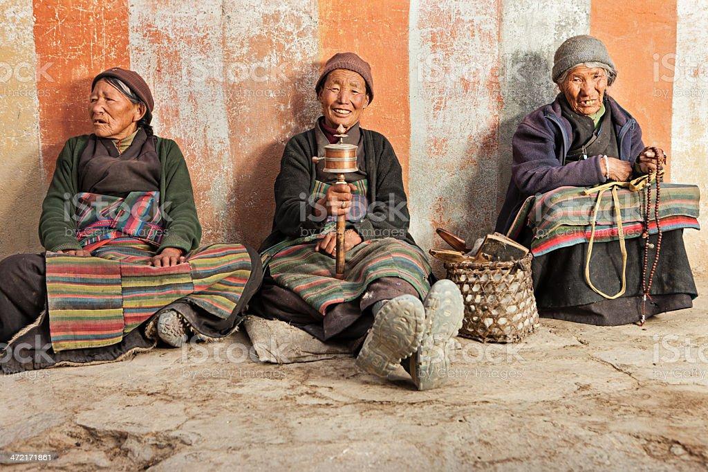 Three Tibetan women praying stock photo