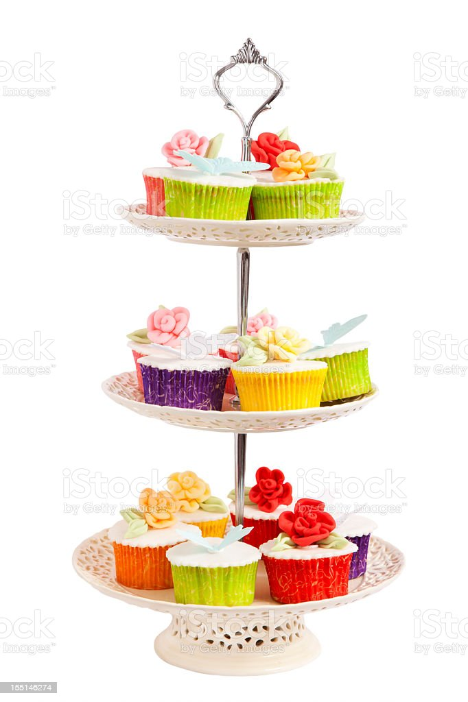Three tiered cupcake server with cupcakes on it stock photo
