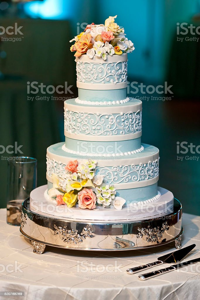 three tiered wedding cake with candy roses stock photo
