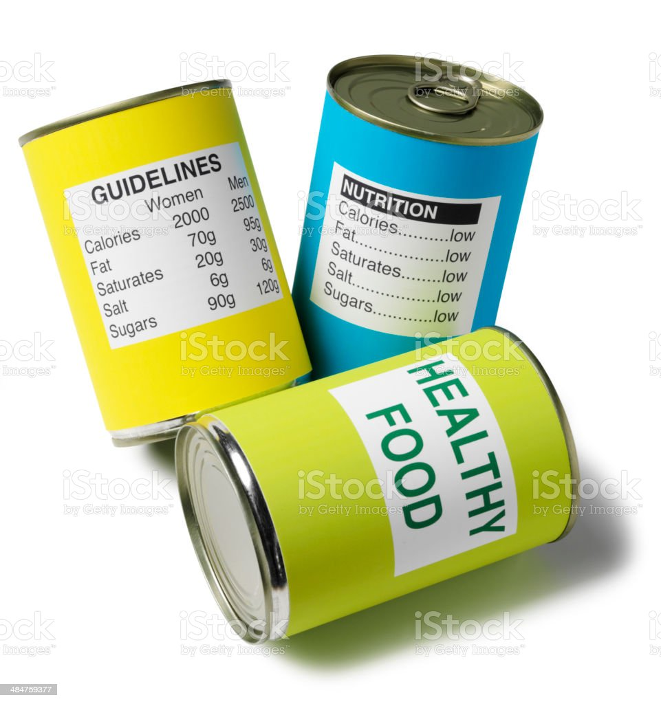 Three Tin Cans with Nutrition and Healthy Food Guidelines stock photo
