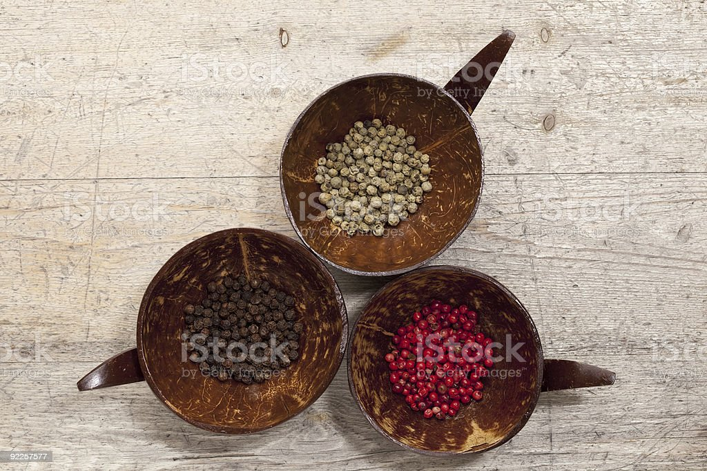 three tipe of peppercorns from above, old wooden background stock photo