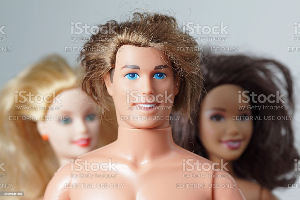 Three toy dolls Barbie, Ken and Teresa smiling friendly faces stock photo