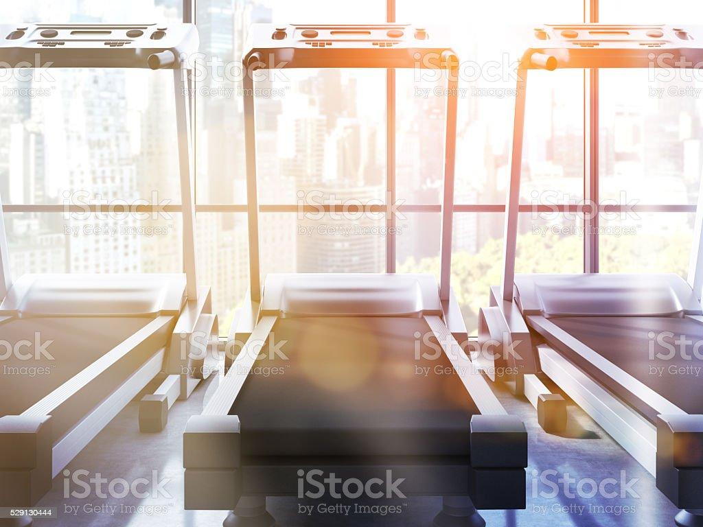 Three treadmills toning stock photo