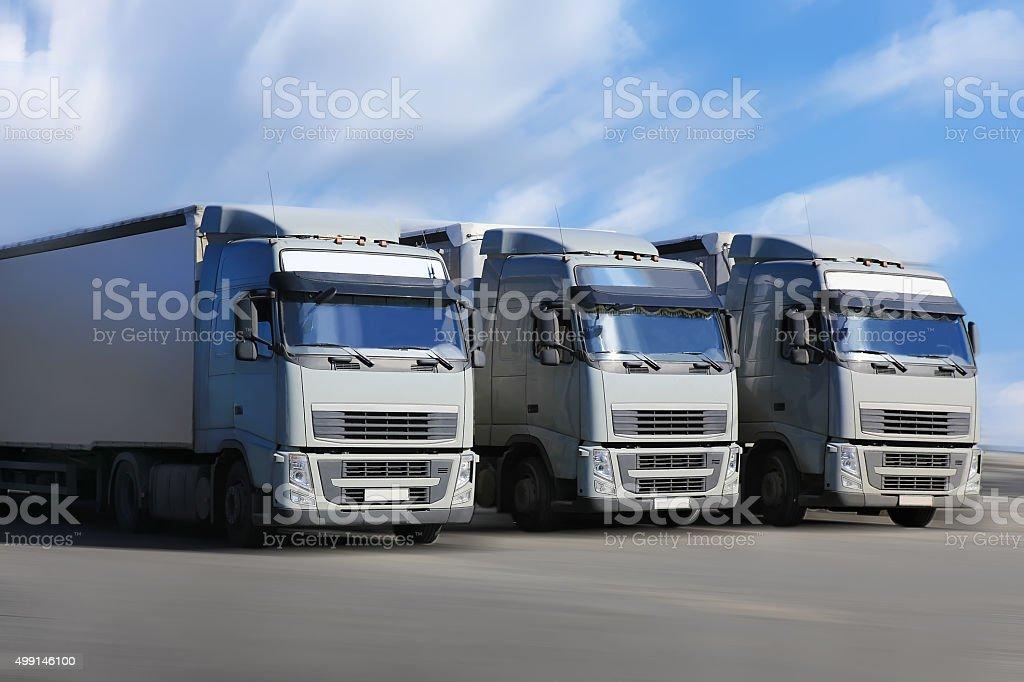 three trucks go on  highway stock photo