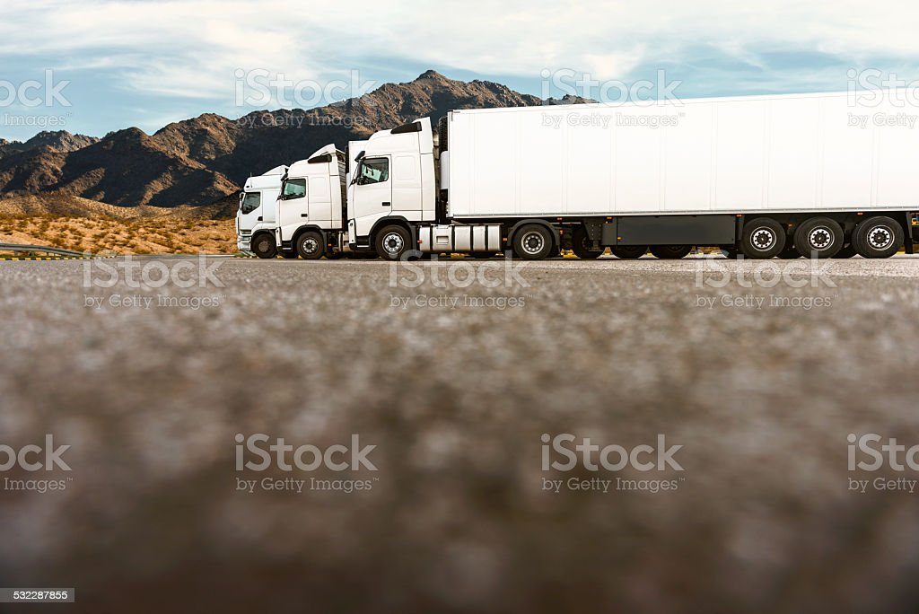 Three trucks in a row of transporting company stock photo