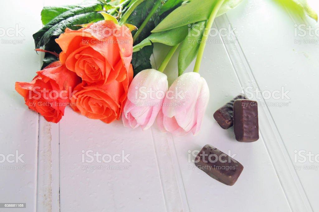 Three tulips on a white background stock photo
