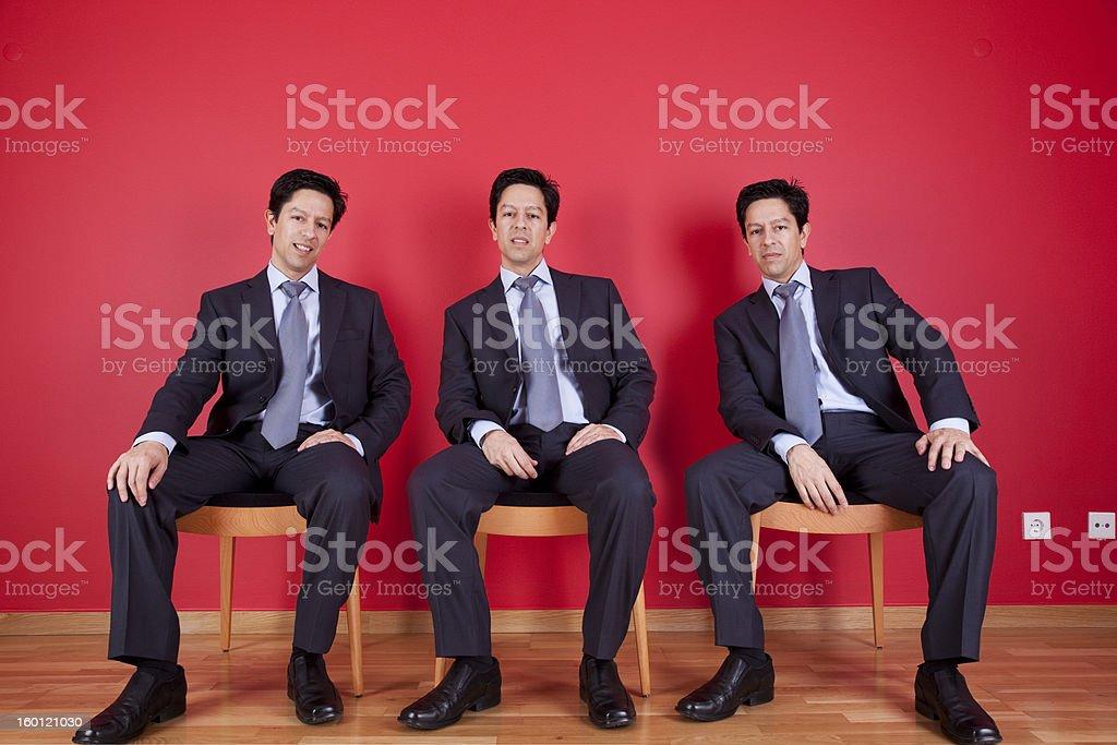 Three twin businessman waiting stock photo