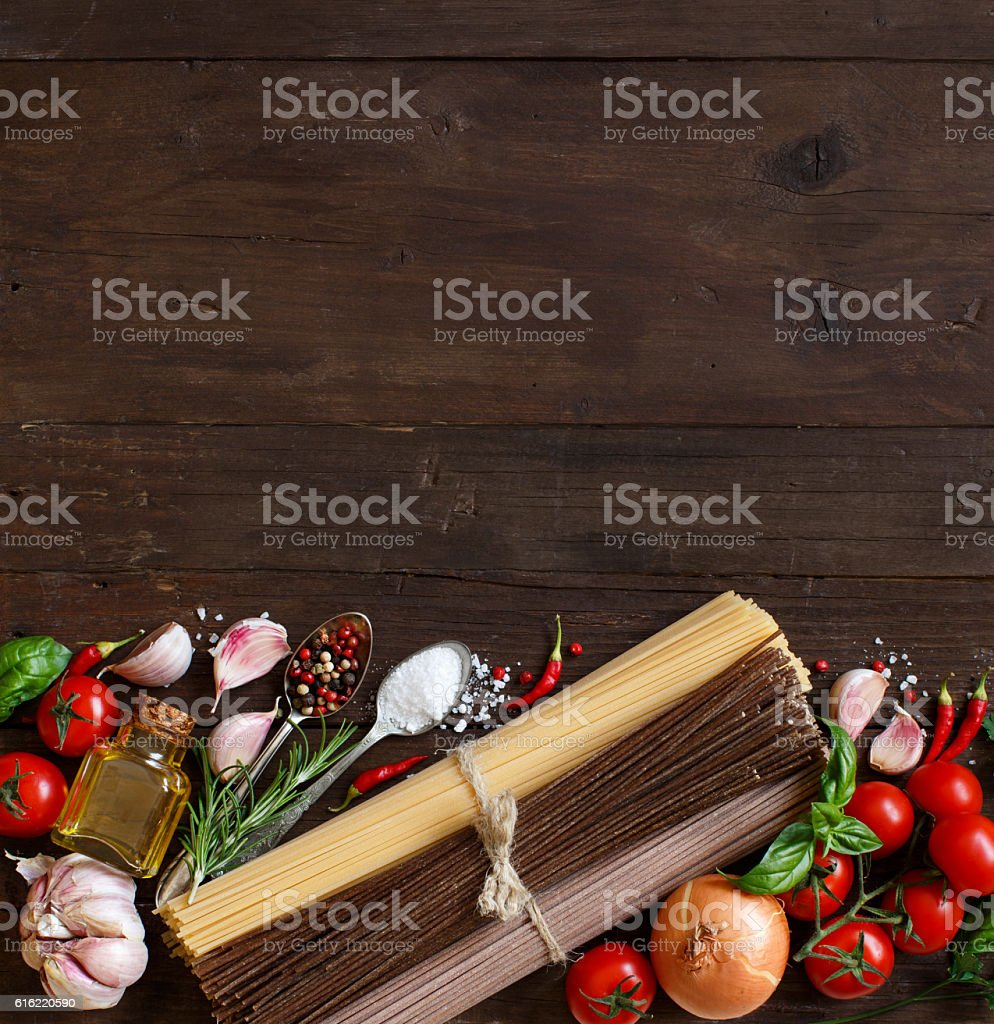 Three types of spaghetti, vegetables and herbs stock photo