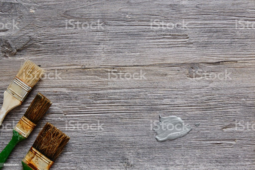 three used paintbrushes with blob on frame stock photo