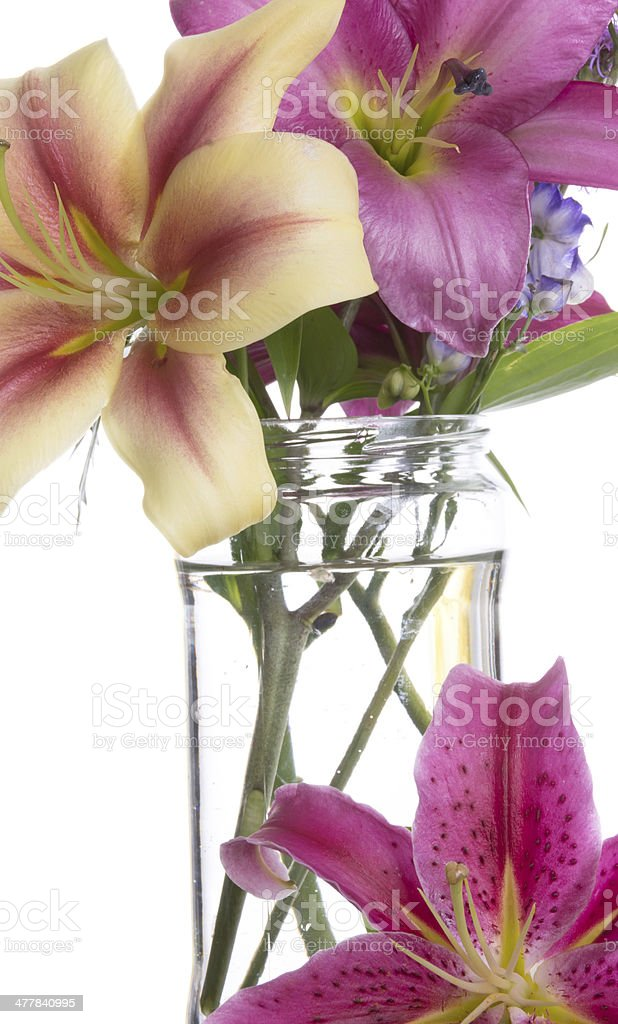 Three varieties of Oriental lily with jar. royalty-free stock photo