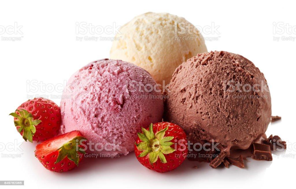 Three various ice cream balls - strawberry, vanilla and chocolate stock photo