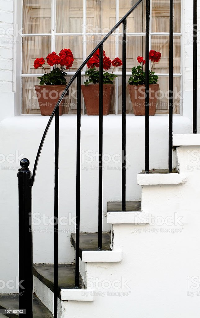 Three vases of geranium on a window sill royalty-free stock photo