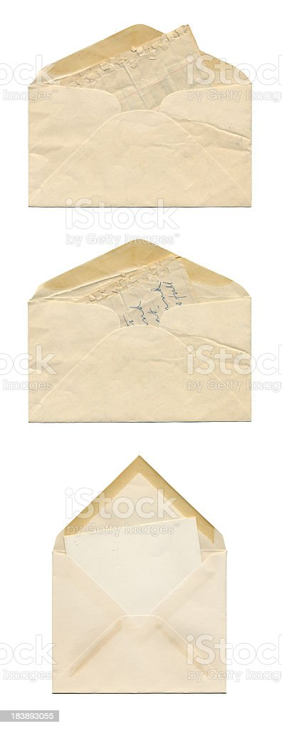 Three Very Old and Yellowed Envelopes on a White Background royalty-free stock photo