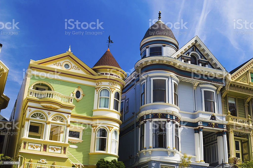 Three Victorian style houses in blue and green stock photo