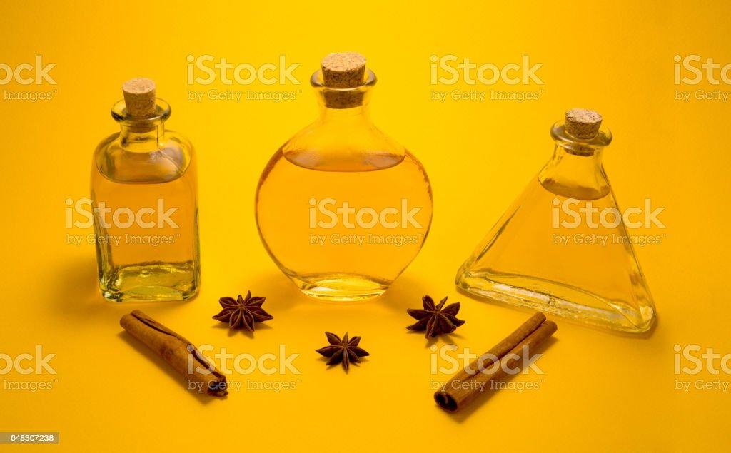 Three vintage glass bottles with spaces on orange background stock photo