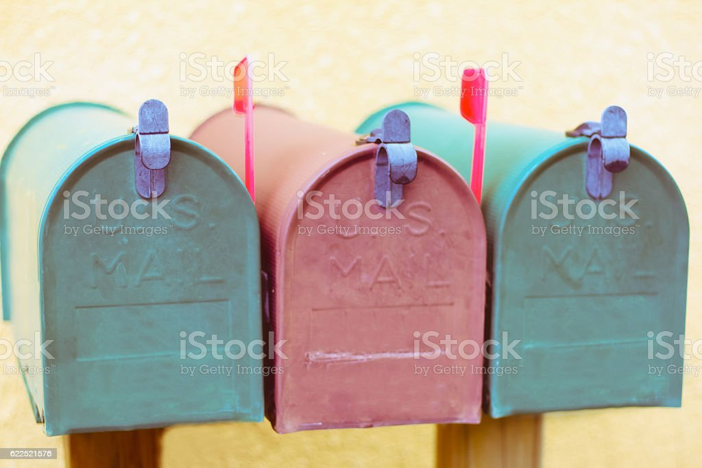 Three Vintage Rural Mailboxes with Red Flags Up stock photo