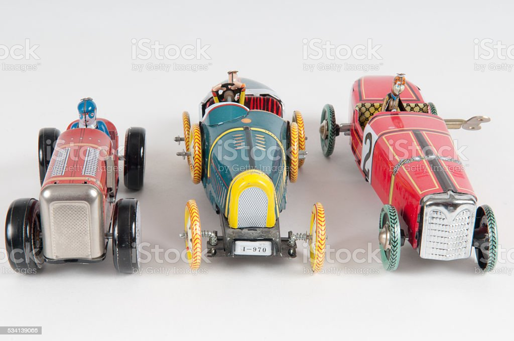 Three vintage toy cars stock photo