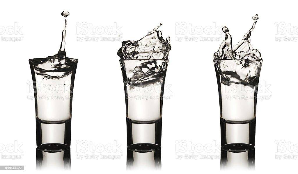 Three vodka glasses with splashes stock photo
