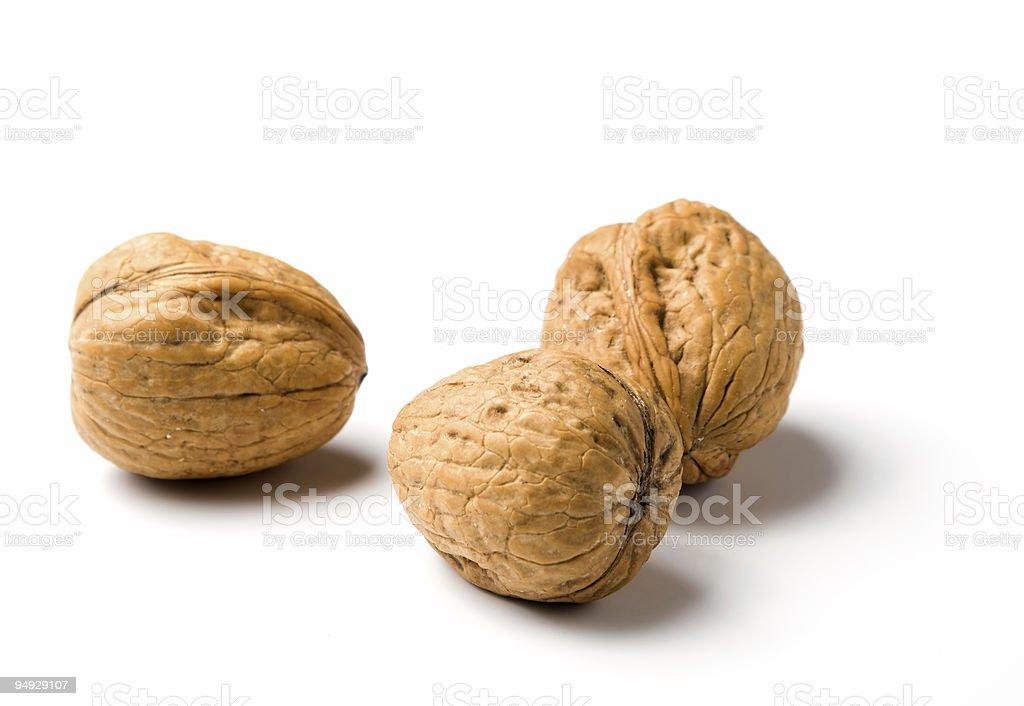 three walnuts isolated on white royalty-free stock photo