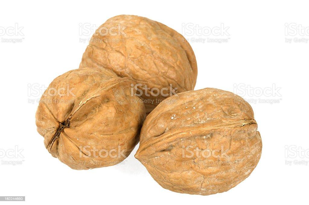 Three walnuts on white background stock photo