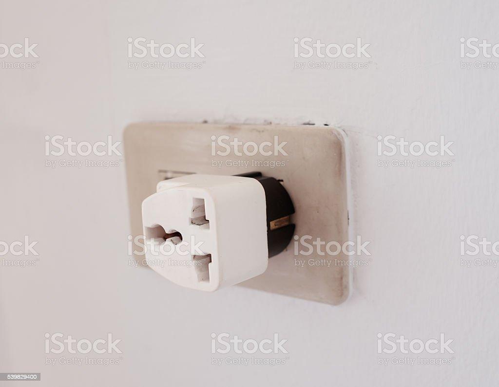 three ways adapter installed wall stock photo